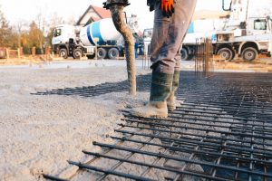 Concrete worker laying a foundation for a business in Jacksonville